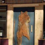 The original cabin door wood carving.